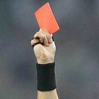 A soccer ref holding up a red card