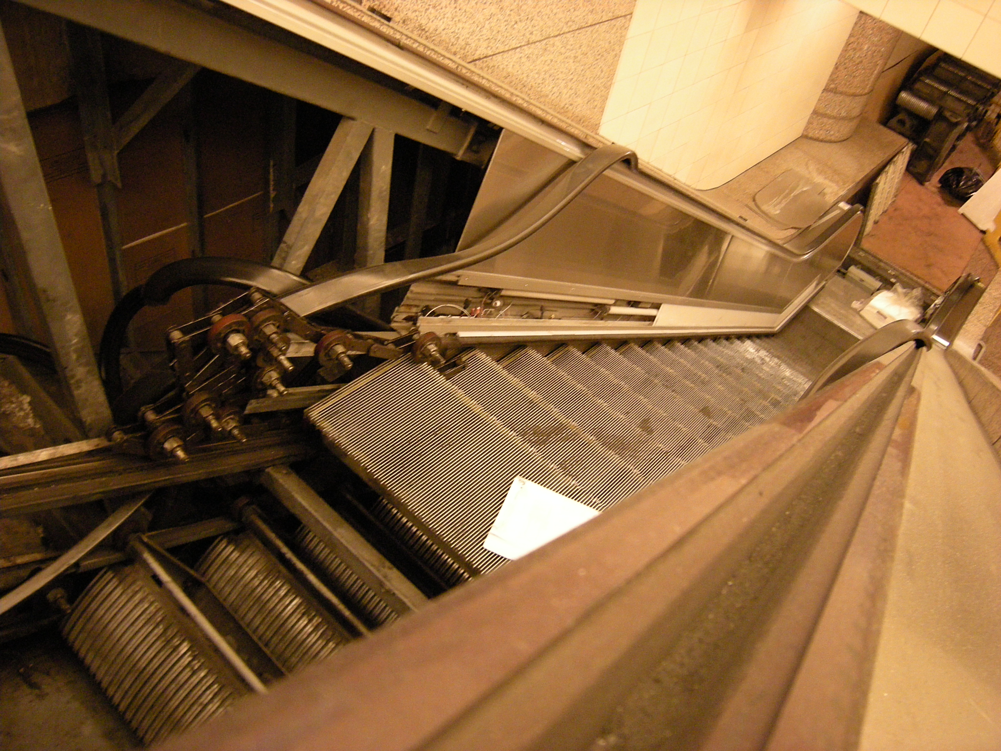 View of escalator steps on continuous chain.