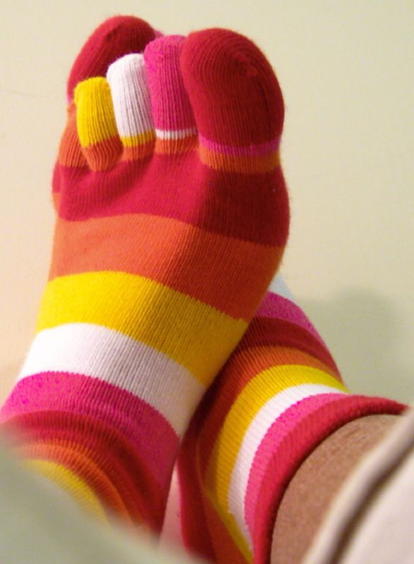 photo of feet in striped toe socks