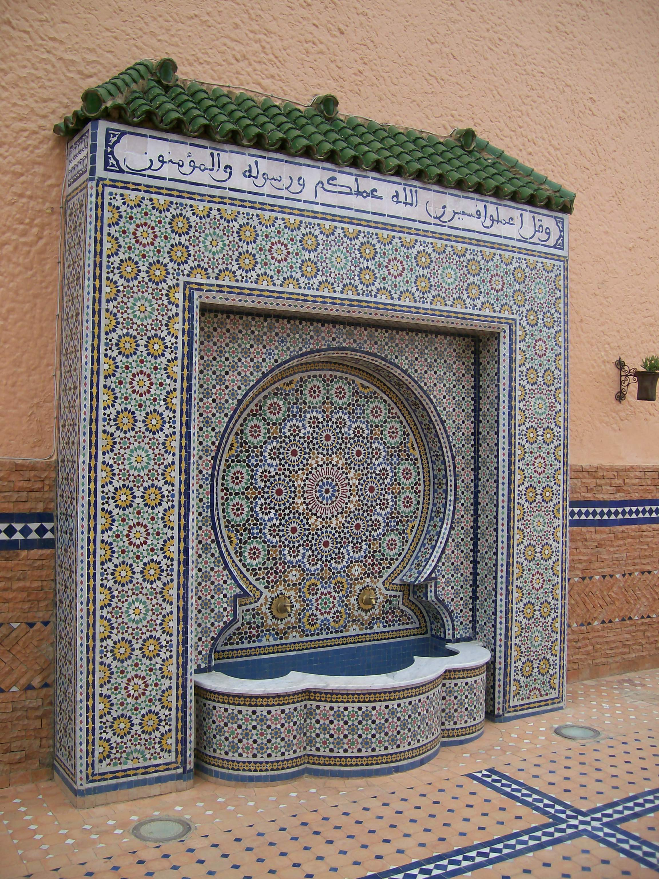 Islamic art: Chamber of Traditional Artisans in Mekne, A traditional Moroccan fountain formed with a series of small colored tiles in mosaic patterns.