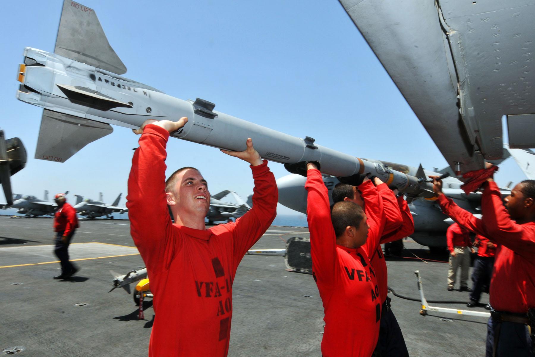 Global Federation National News Network! US_Navy_110520-N-1004S-449_Sailors_attach_an_Aim-9x_Sidewinder_missile_to_an_F-A-18C_Hornet_aboard_the_aircraft_carrier_Ronald_Reagan_(CVN_76)