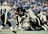 Walter Payton (34) pictured breaking the NFL's career rushing record on October 7, 1984..