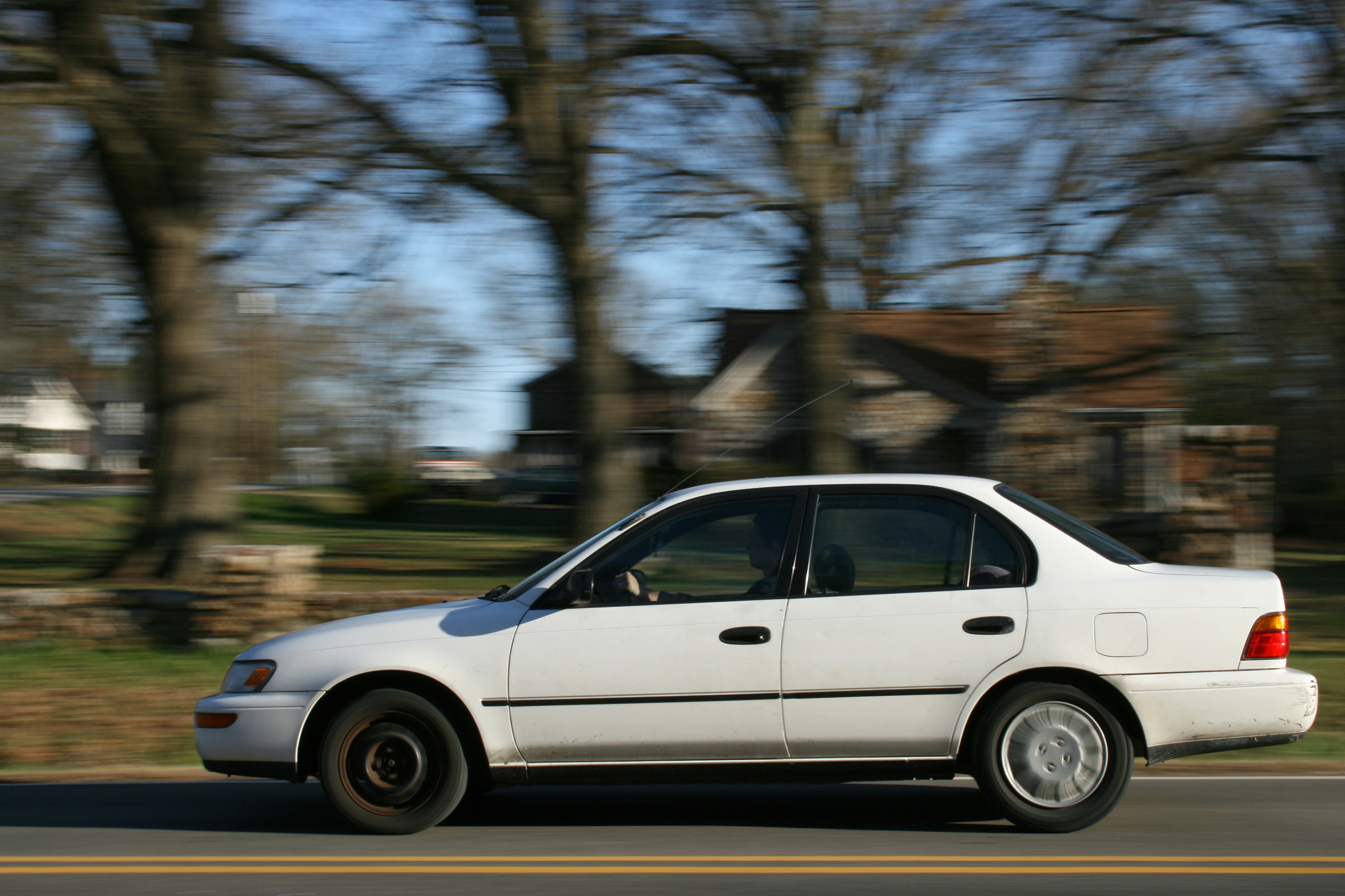 Car Tire Size >> File:2009-03-20 White car EB on E Geer St in Durham.jpg - Wikimedia Commons