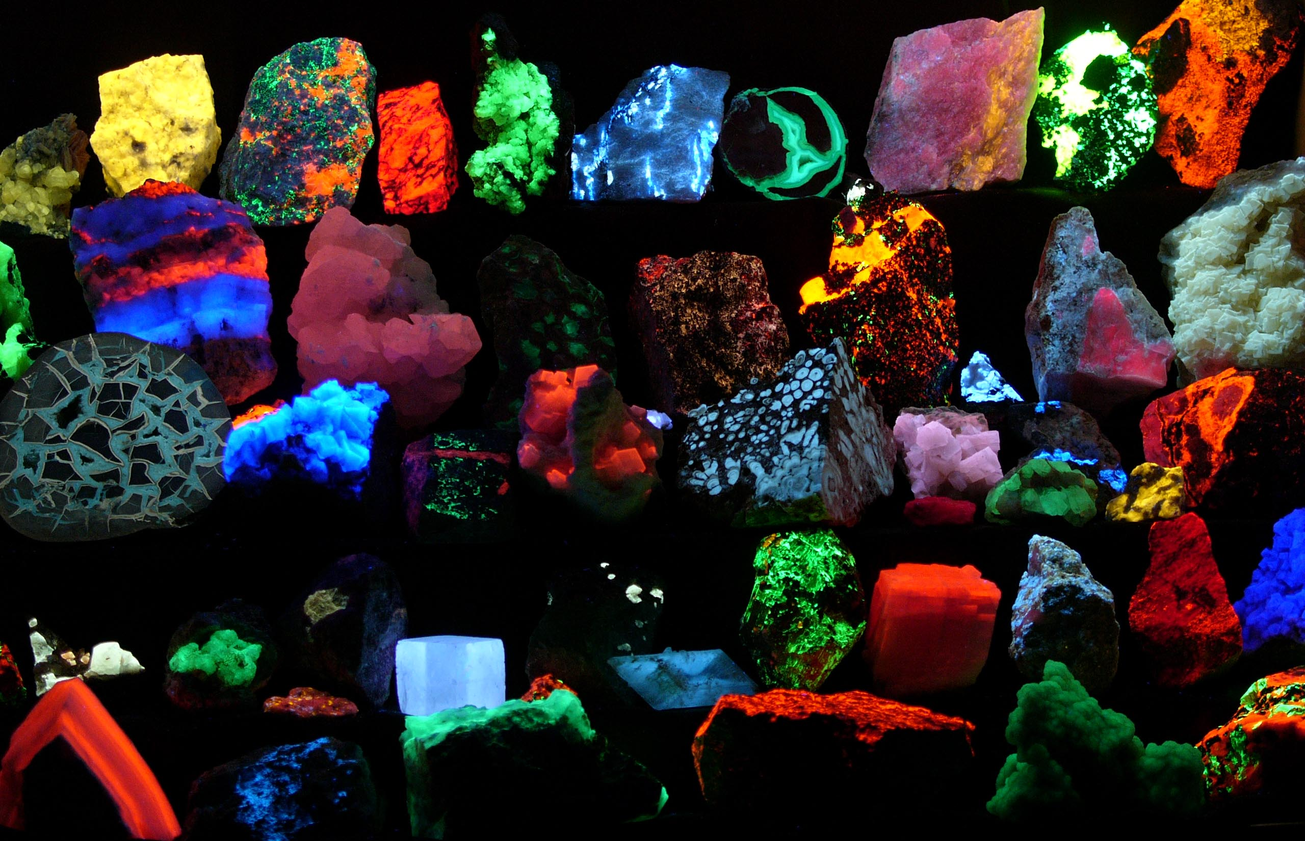 Collection of various fluorescent minerals under ultraviolet UV-A, UV-B and UV-C light. Image Credit: Hannes Grobe/AWI