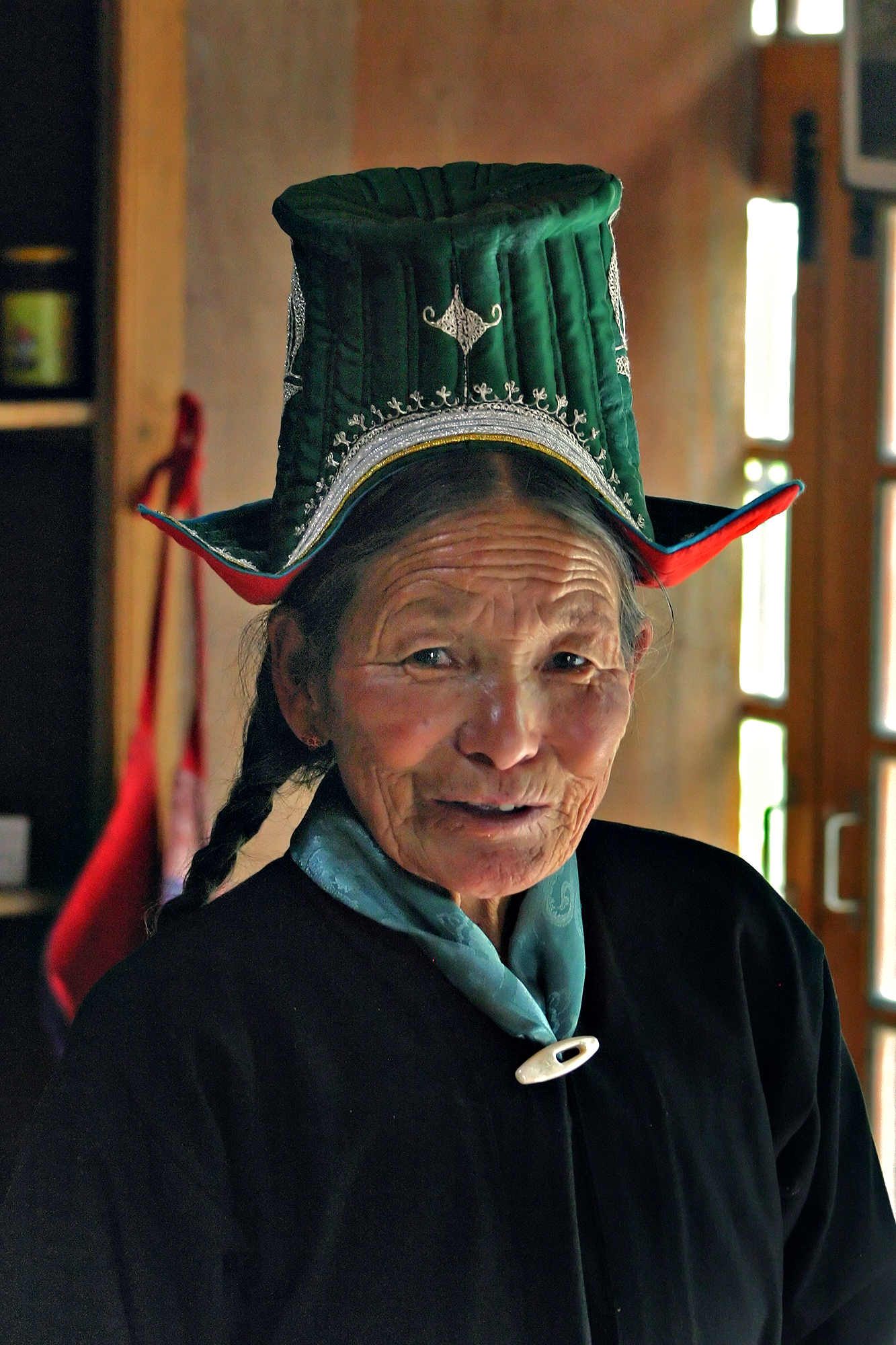 A Ladakhi woman in a traditional dress and hat