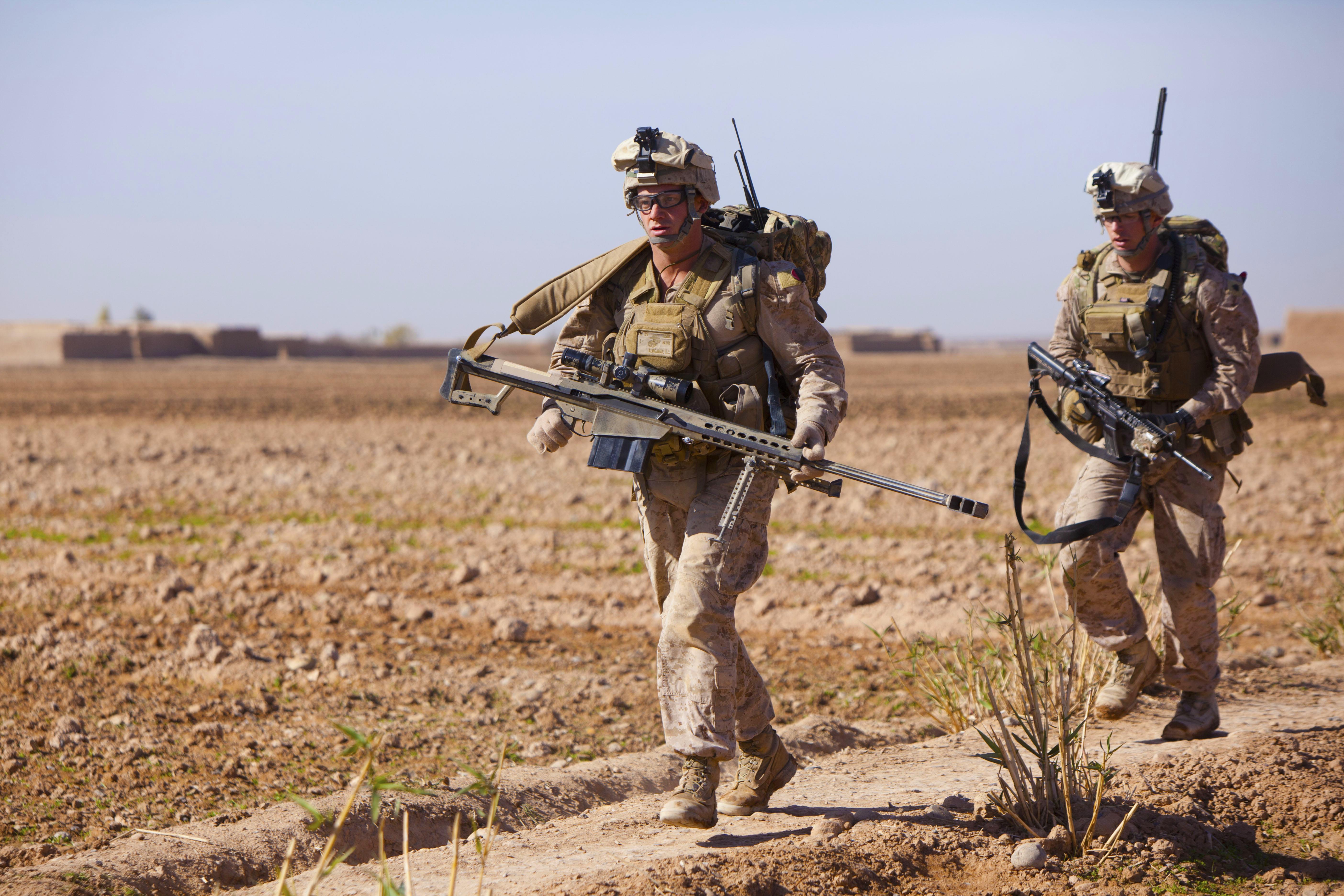 US Marine sniper running with a Barrett .50 cal rifle ...