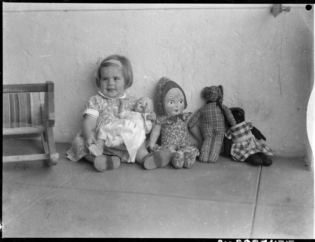 File Young Child With A Baby Doll On Her Lap And A Rag