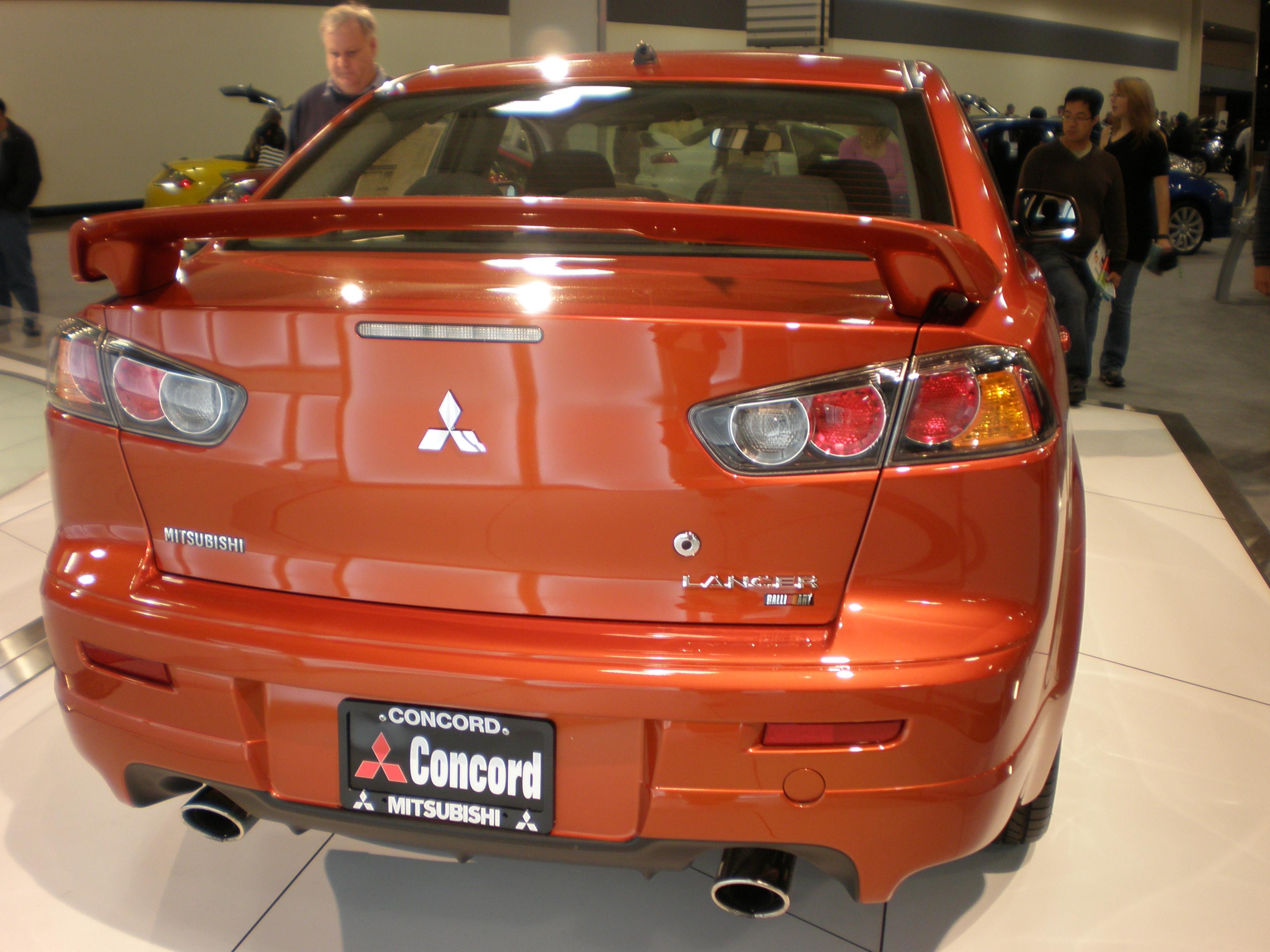 File 2009 Orange Mitsubishi Lancer Ralliart Sedan Rear Jpg Wikimedia Commons