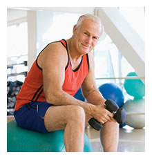 middle aged man exercising with weights