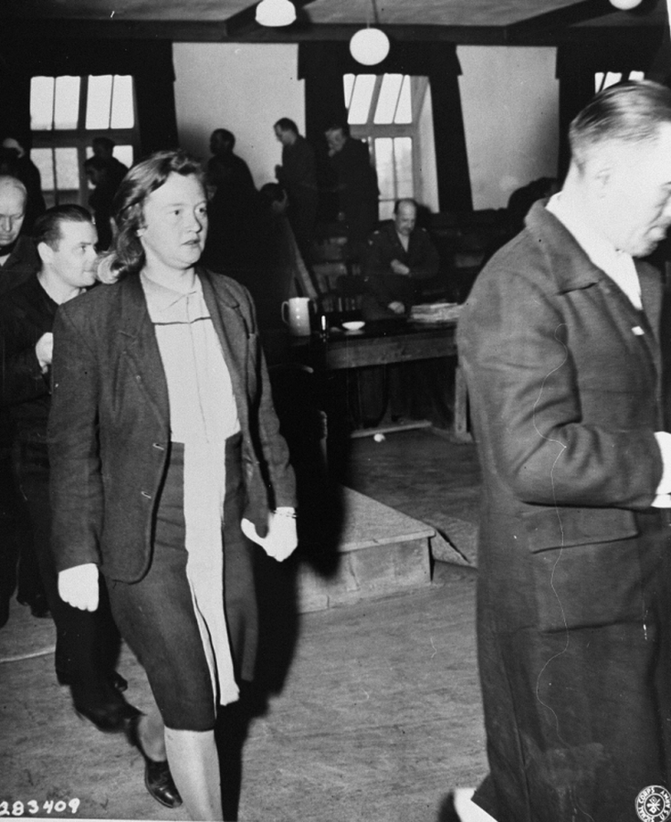 Ilse Koch leaves the courtroom with her co-defendants during the trial of former camp personnel and prisoners from Buchenwald.