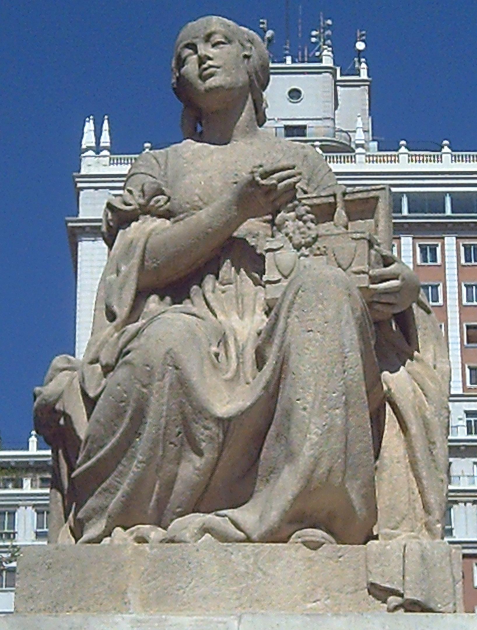 Дульсинея Тобосская, статуя у памятника Сервантесу в Мадриде. Скульптор Federico Coullaut-Valera (1912–1989)