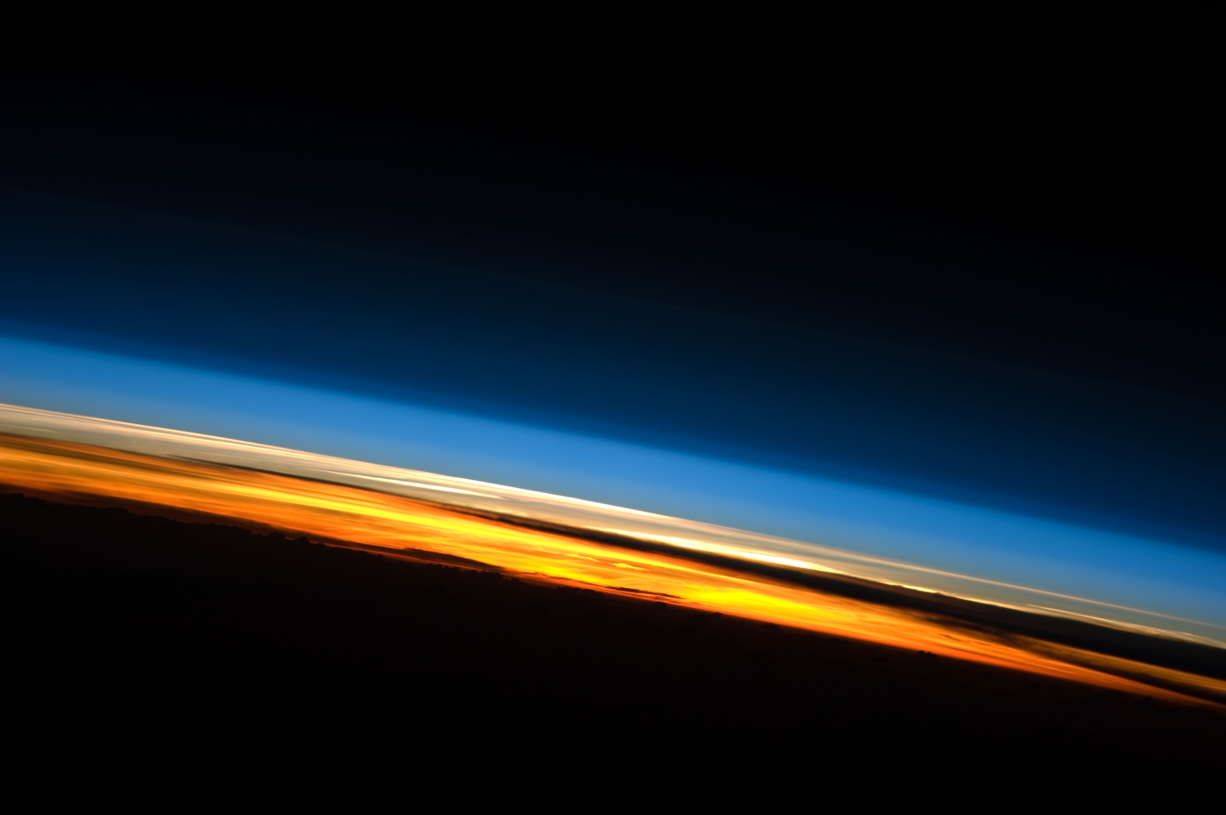 Limb view, of the Earth's atmosphere. Colours roughly denote the layers of the atmosphere.