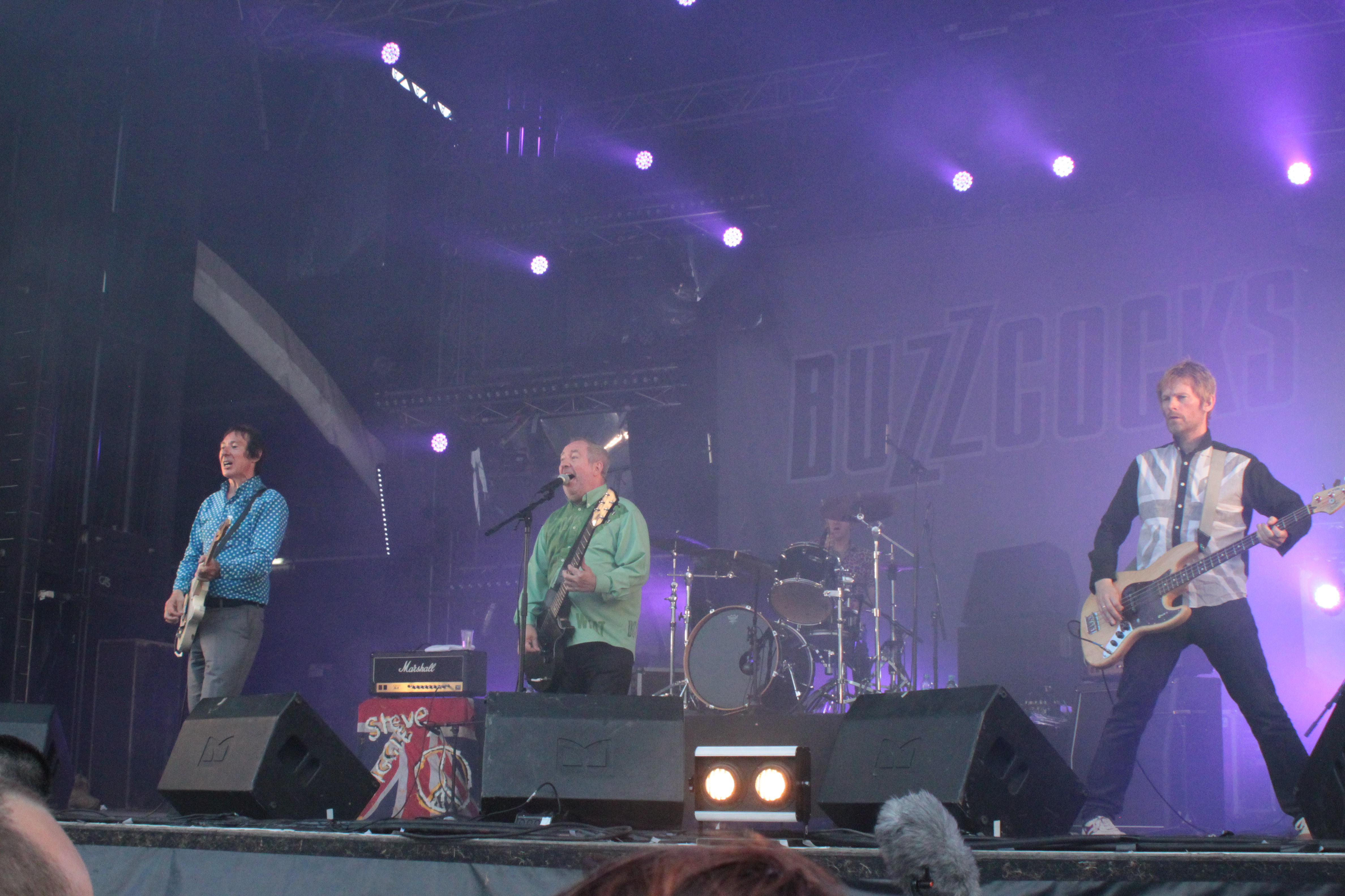 Left to right: Steve Diggle, Pete Shelley, Danny Farrant and Chris Remington, performing live at Hellfest 2013.