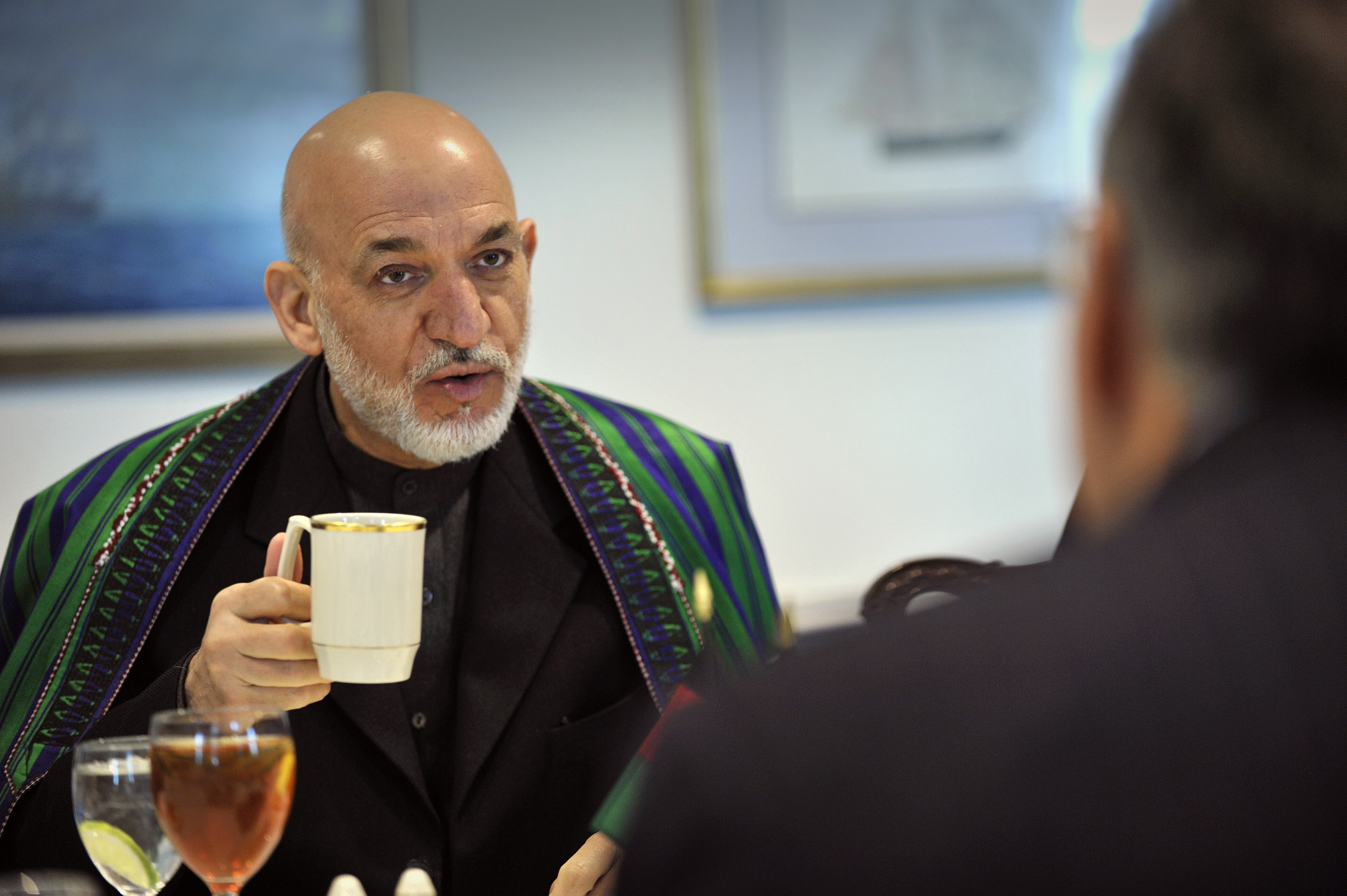 fileafghanistans president hamid karzai offers a brief cultural exchange discussing tea etiquette back in his country as he gestures with a pentagon cup