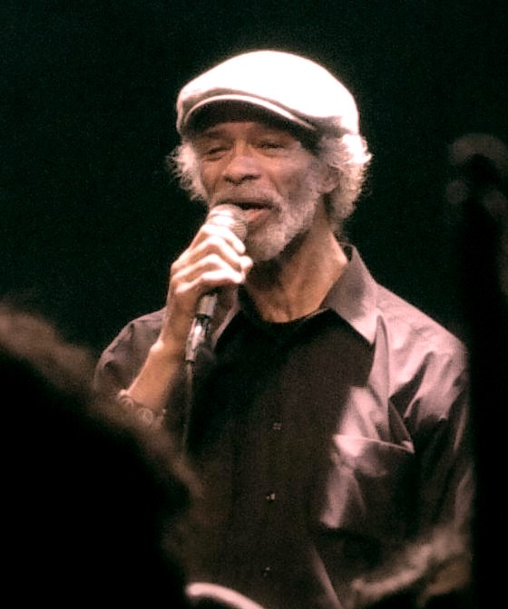 first rapper ever, Gil Scott Heron, performing on stage