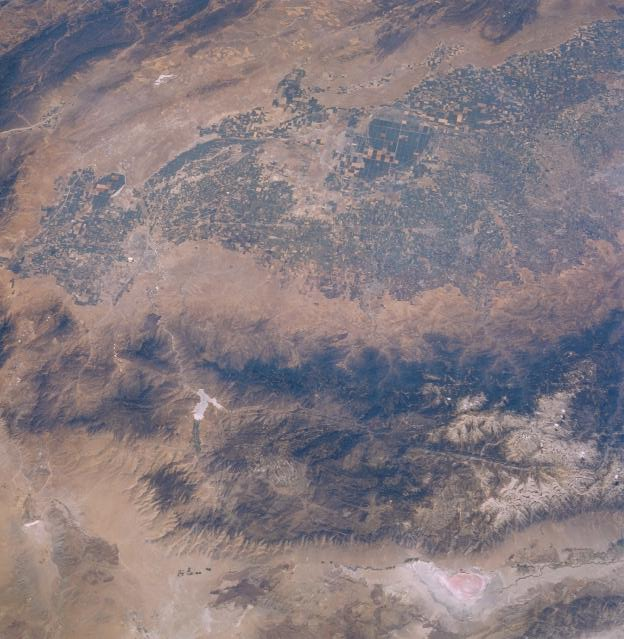 Here is a view of the Sierra Nevada mountains and surroundings from Earth orbit, taken on the STS-51-F mission in 1985. Owens Lake is in the lower right, with a reddish tint.