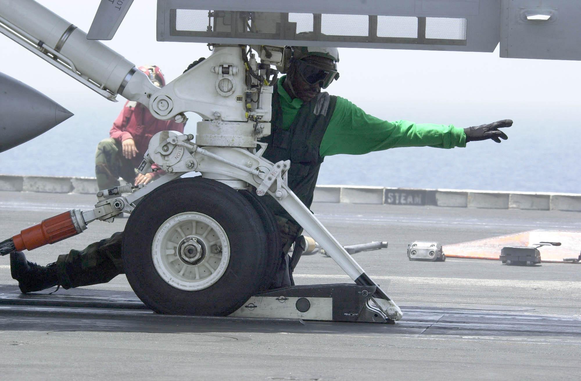 US_Navy_030625-N-9319H-005_A_Nimitz_crew