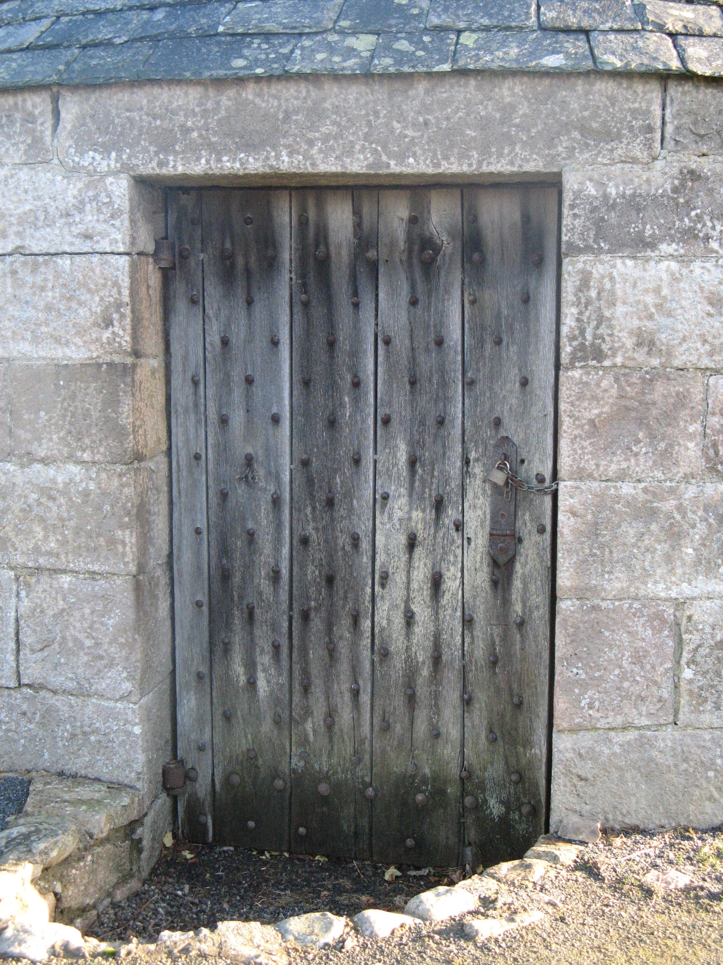 Wooden door set in stone wall