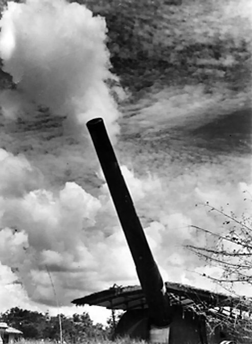 One of Singapore's 15-inch coastal defence guns elevated for firing Coastal defence gun at Singapore.jpg