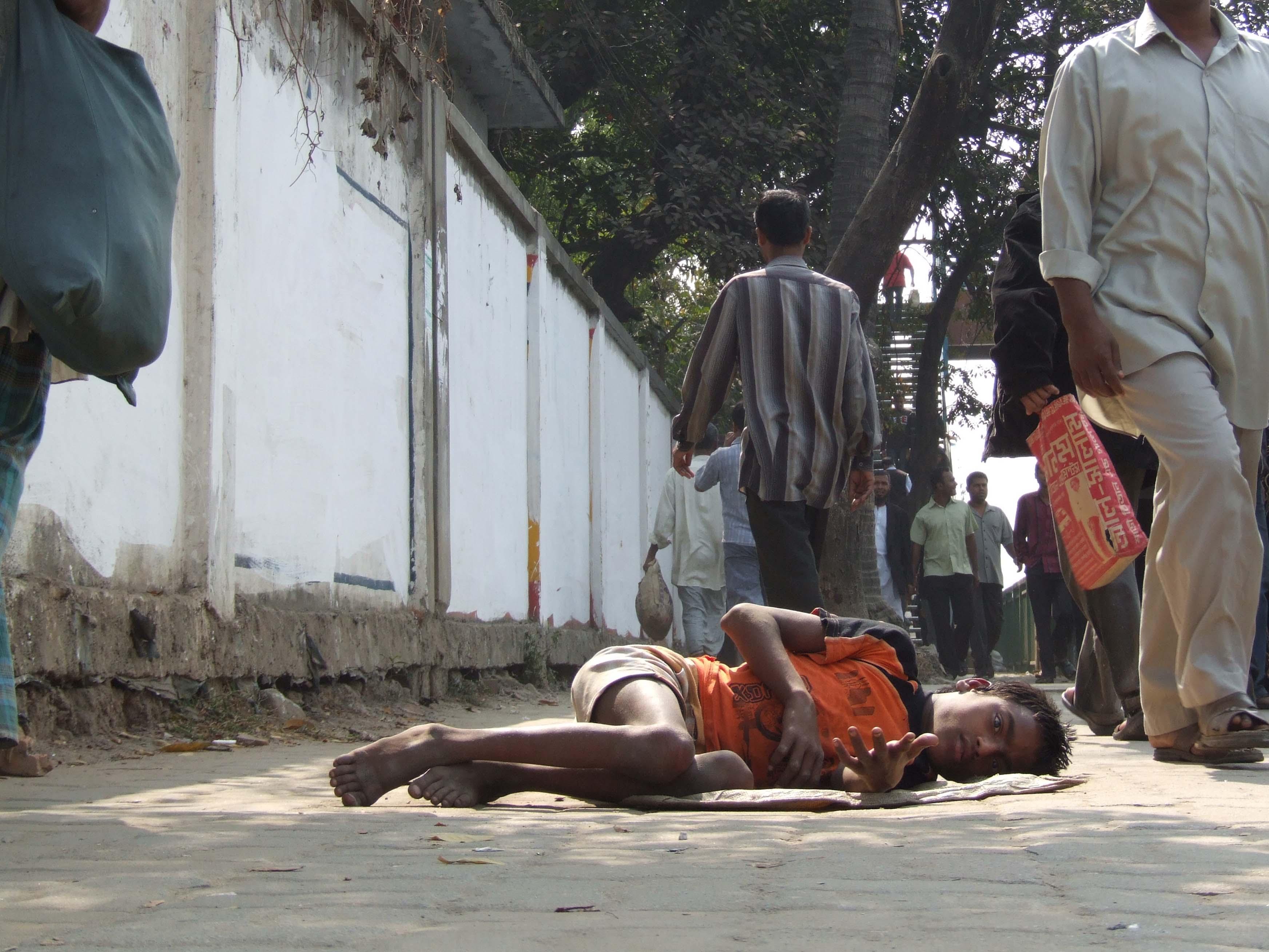 Disabled beggar in Dhaka, Bangladesh.