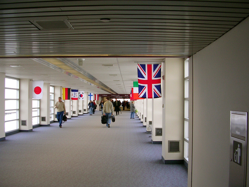 Walkway connecting terminals in the Eastern Iowa Airport featuring flags from many countries. Picture from Wikimedia.