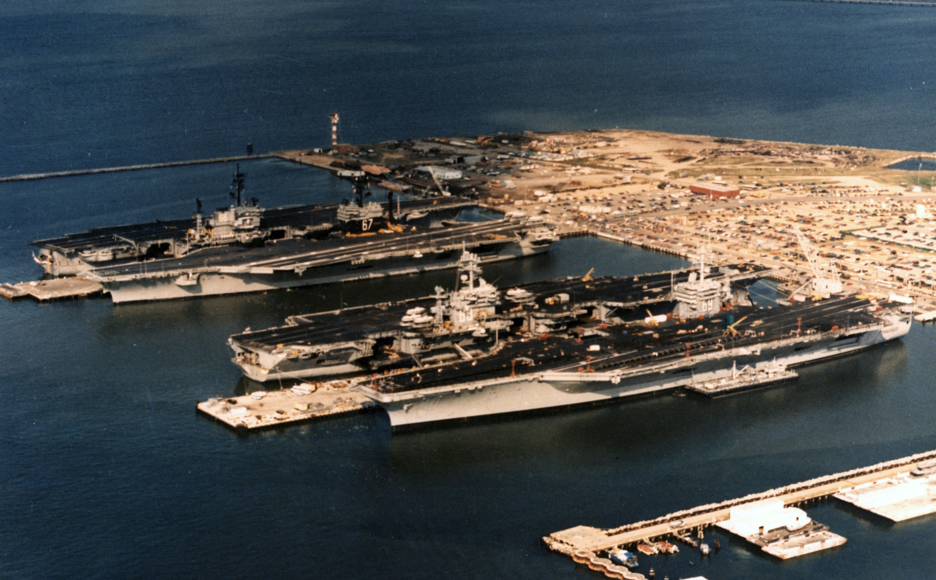 File:Four US Navy carriers at Norfolk Naval Station 1985 ...
