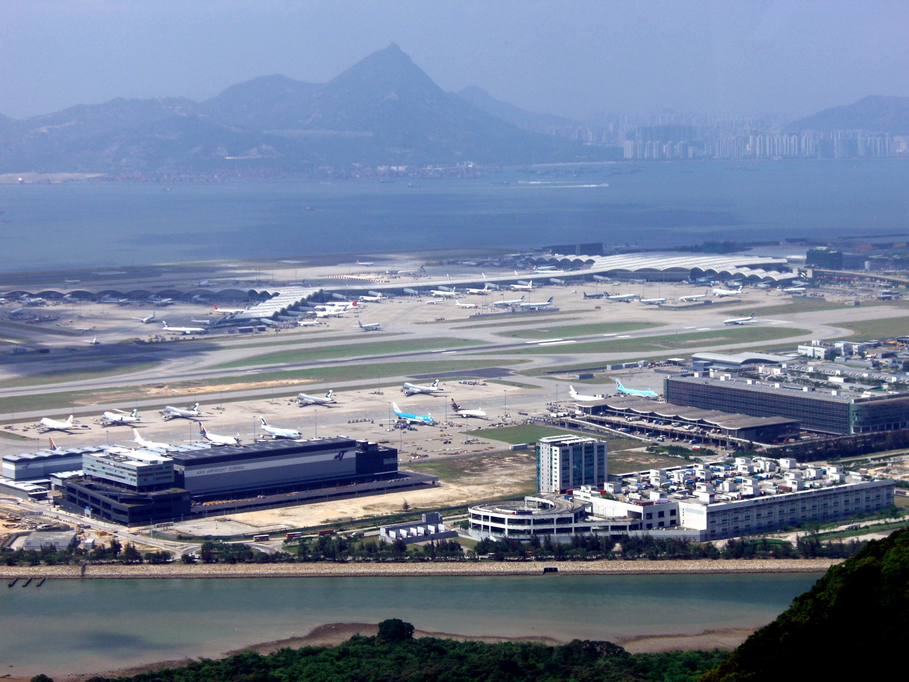 hong kong airport Hong kong international airport (iata: hkg, icao: vhhh) is the main airport in  hong kong, built on reclaimed land on the island of chek lap kok the airport is .