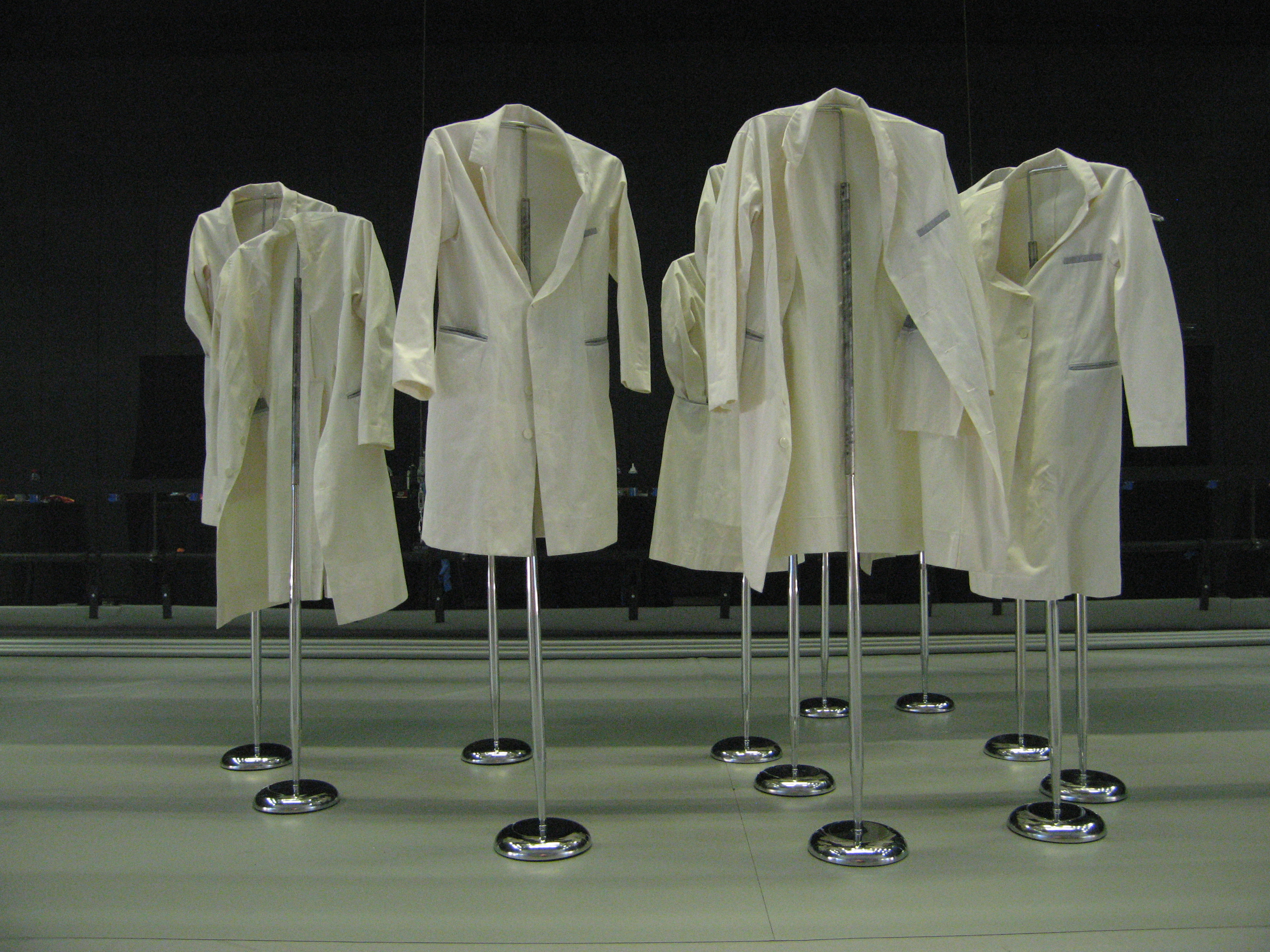 Image of lab coats on hangers.