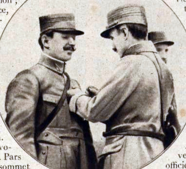 "The ""first French ace"", Frenchman Adolphe Pegoud being awarded the Croix de guerre. Pegoud croix de guerre.jpg"