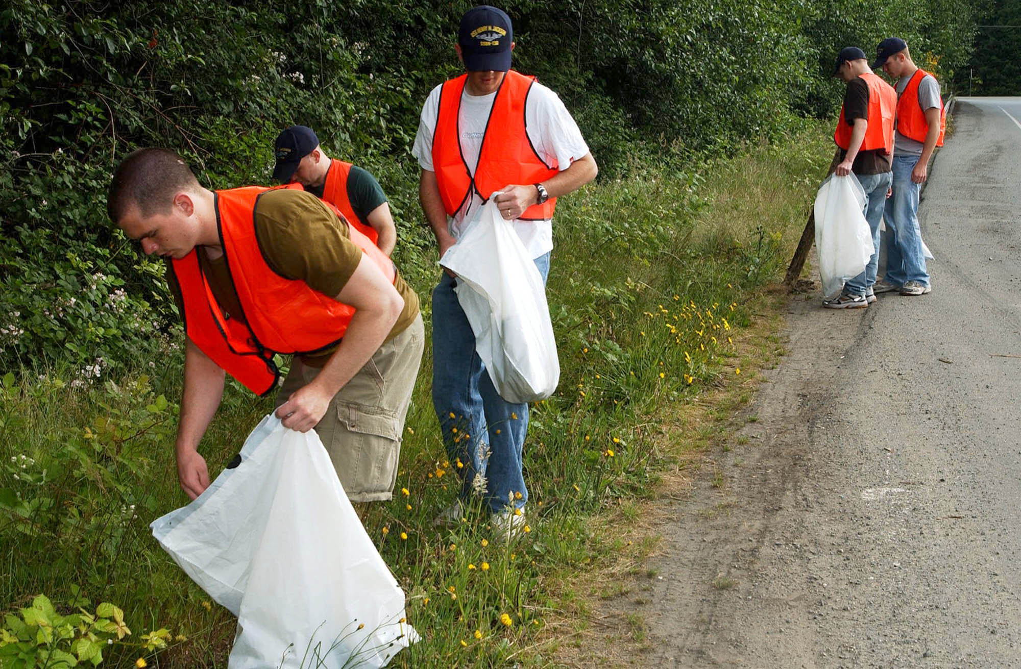 Image result for people picking up litter