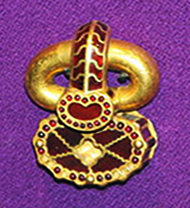 A golden object decorated with small gems