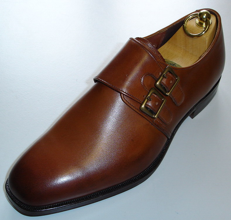 Product Features Classic single buckle monk strap oxfords featuring wing tip and brogue design.