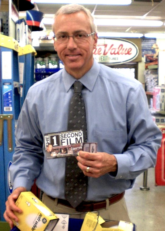 Dr. Drew (David Pinsky) holding a producer cre...