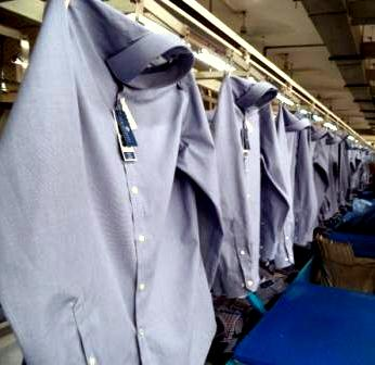 Shirt production line in a Bangladeshi factory. Bangladesh is the world's second-largest textile exporter, after China Dress Shirt on Conveyor in a RMG factory of Bangladesh.JPG