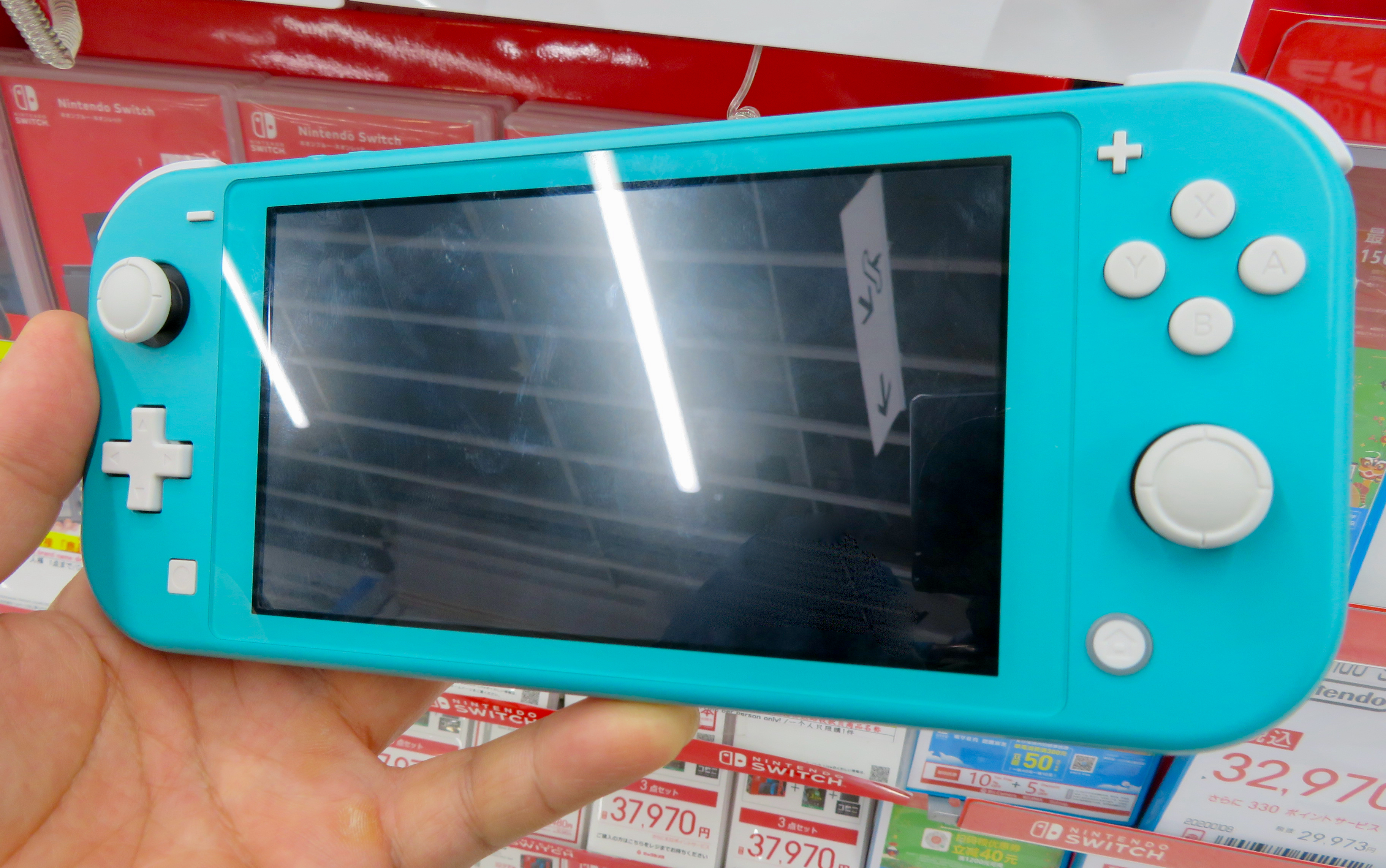 File:Nintendo Switch Lite (turquoise) - 1.jpg - Wikimedia Commons