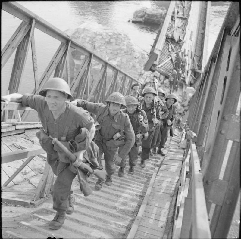 Infantry makes use of the wrecked road bridge