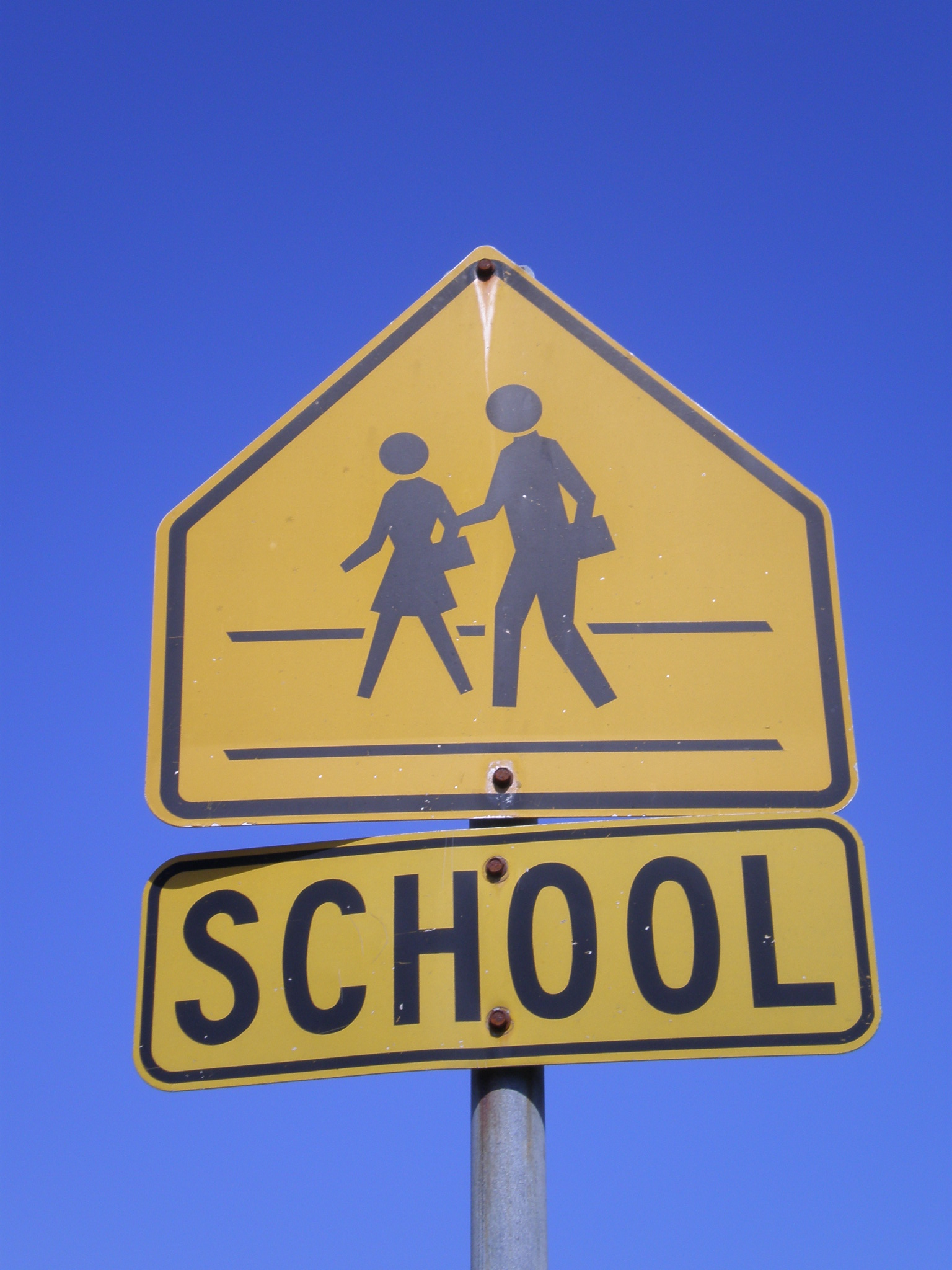 Description yellow school sign