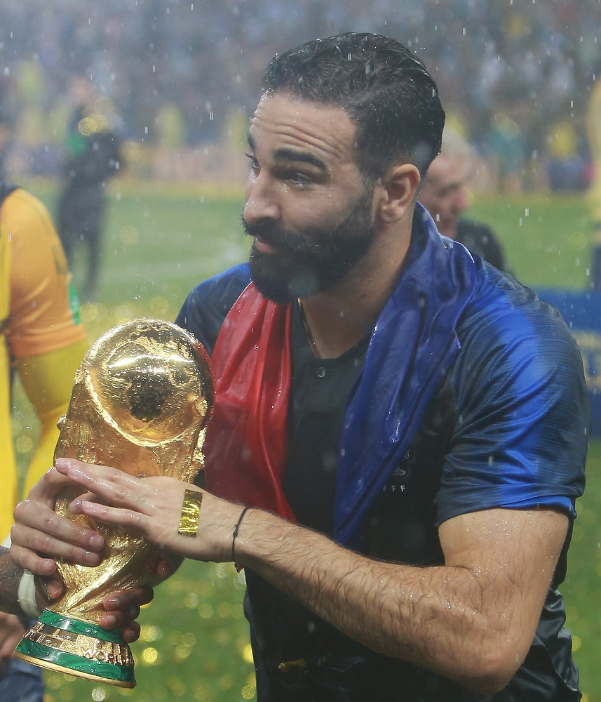 The 32-year old son of father (?) and mother(?) Adil Rami in 2018 photo. Adil Rami earned a  million dollar salary - leaving the net worth at 8 million in 2018