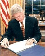 Bill Clinton signing document