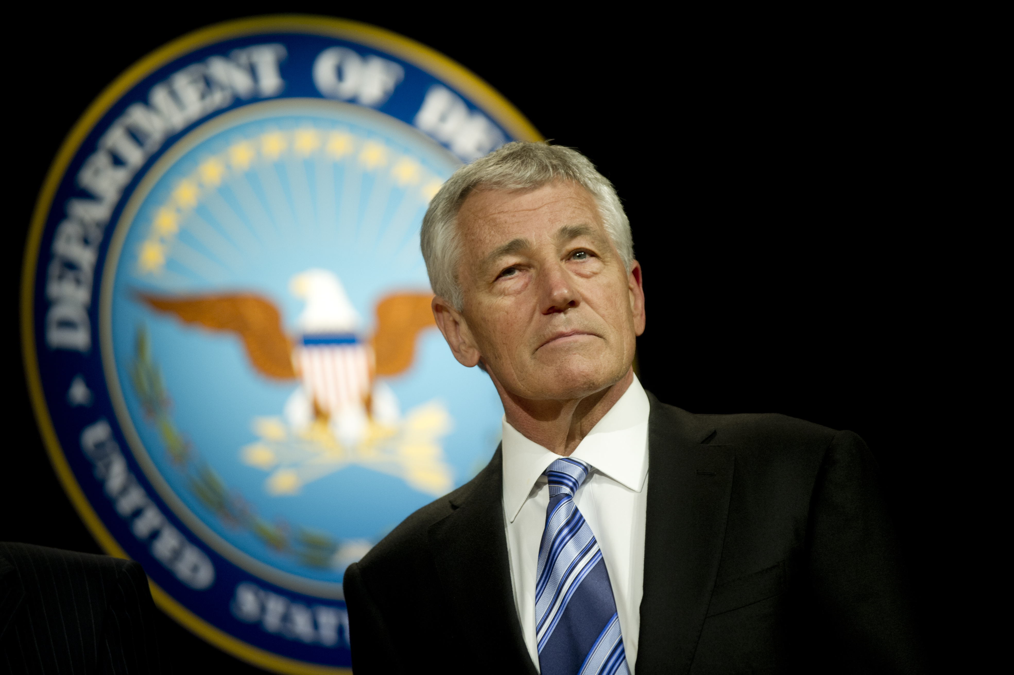 http://upload.wikimedia.org/wikipedia/commons/1/17/Defense_Secretary_Chuck_Hagel_stand_during_the_playing_of_the_service_melodies_after_a_welcoming_and_swearing_in_ceremony_at_the_Pentagon.jpg