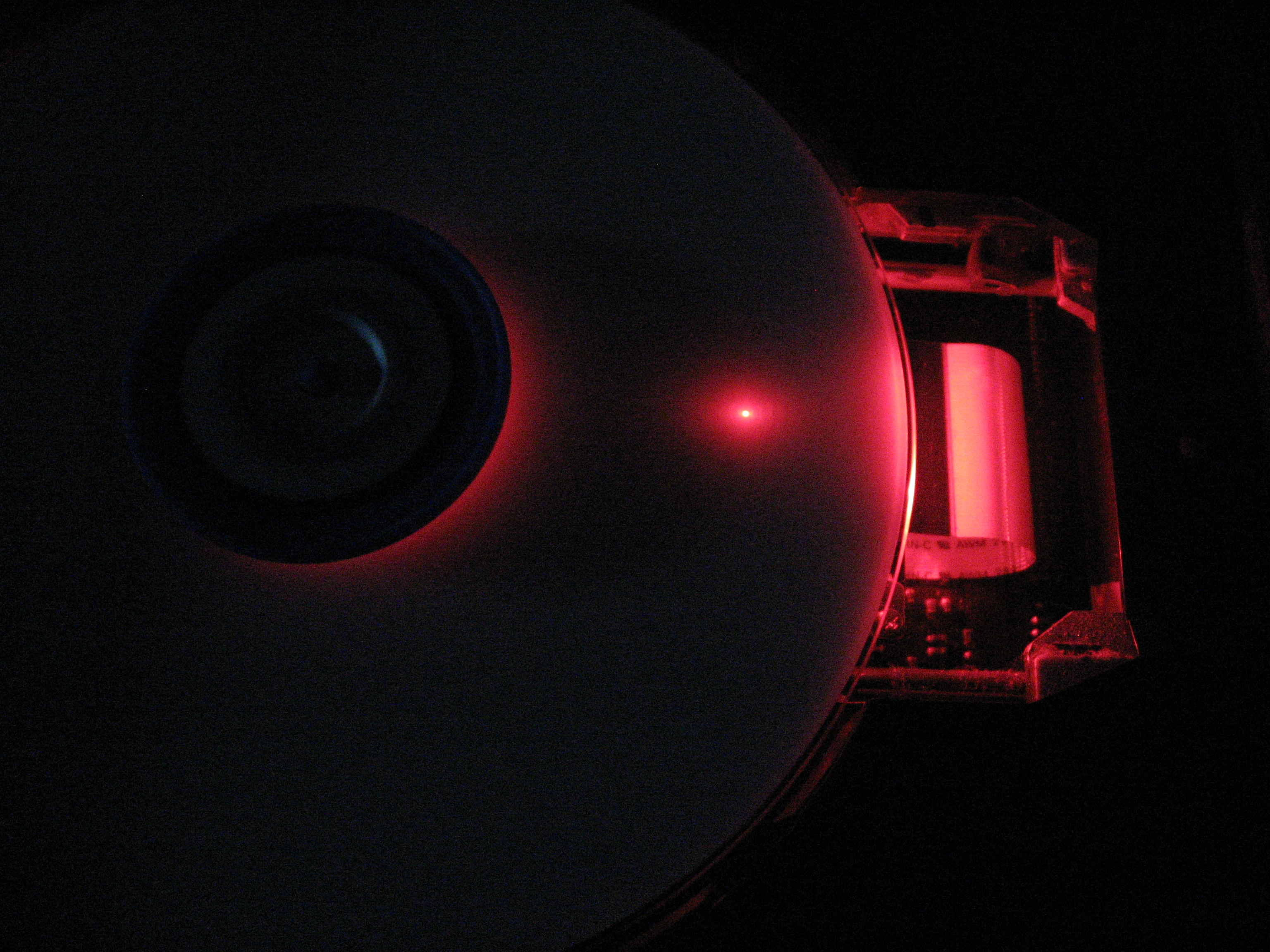 DVD-RW Drive operating with the protective cover removed.