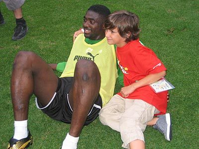 Toure With a Young Fan.jpg