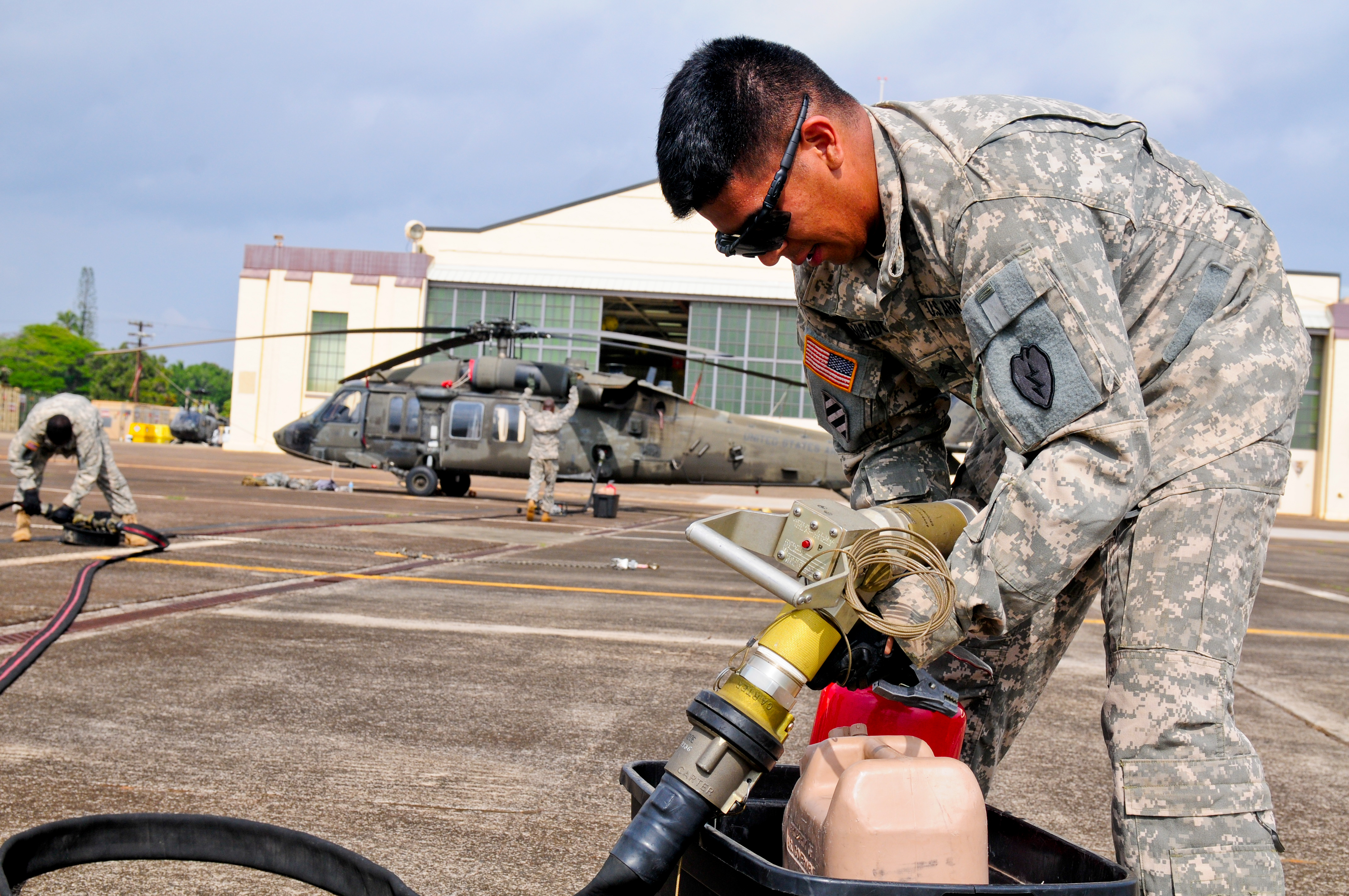 helicopter refueling with File U S  Army Sgt  Greg Alvarado  A Petroleum Supply Specialist With Echo  Pany  2nd Battalion  25th Aviation Regiment  25th  Bat Aviation Brigade  25th Infantry Division  Inspects A Fuel Nozzle On 131120 A Ug106 034 on Giving Eyes To Aircraft Carriers as well Types Of Aviation Fuel as well Boeing Ch 47 Chinook further File RAF Puma HC1 Helicopter Over London MOD 45153141 also Glasgow Helicopter Crash Mystery 76kg Of Fuel In Tank.