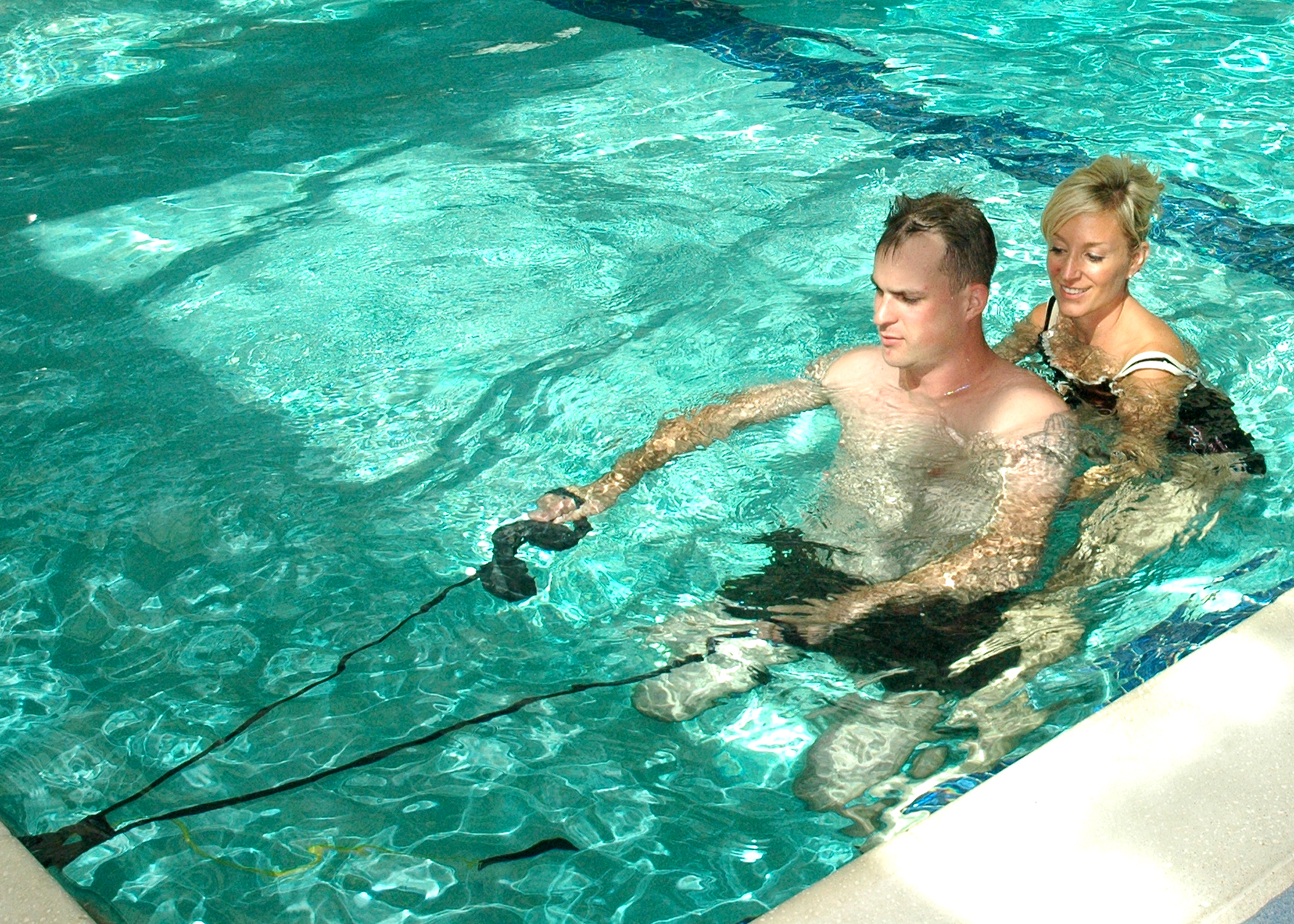 US Navy 091001-N-6326B-090 Lyn A. Boulanger, a Naval Medical Center San Diego occupational therapist, assists Marine Corps Staff Sgt. Jesse A. Cottle, a bilateral amputee, while he practices swimming during endurance training.jpg