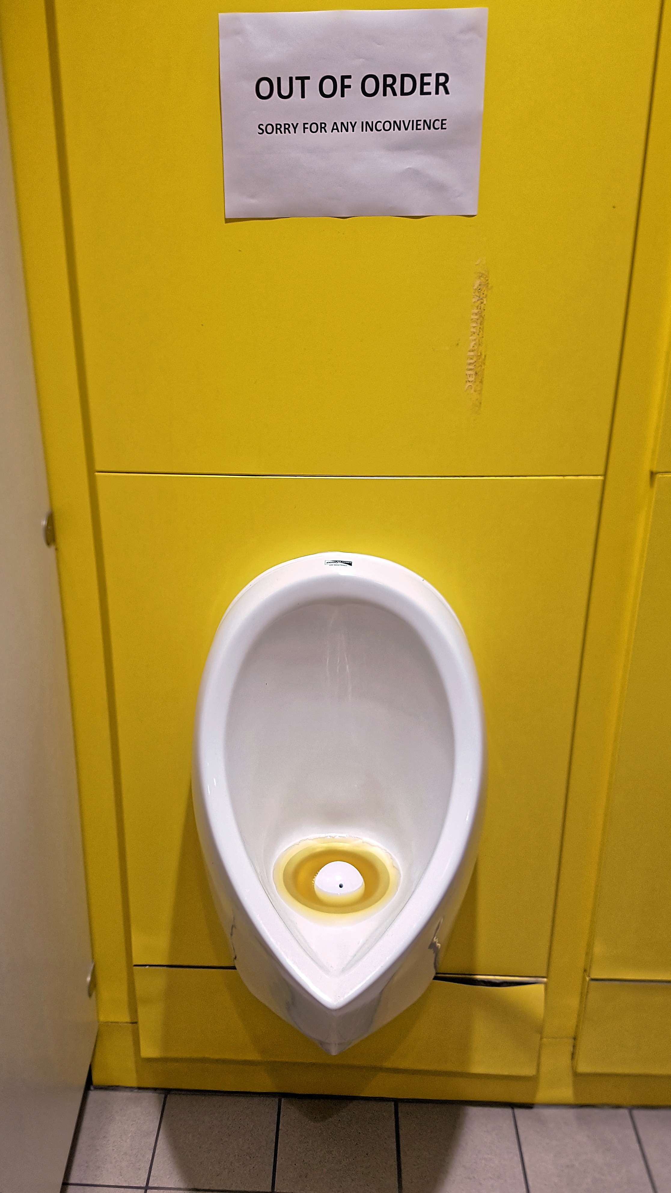 File Zero Flush Blocked Urinal And Out Of Order Sign At
