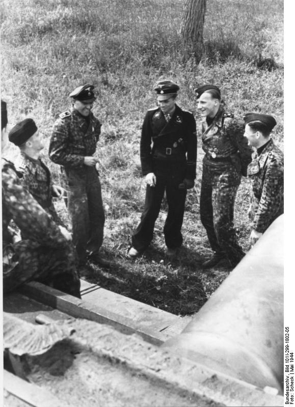 Wittmann smoking with his men