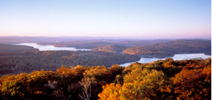 Western Maryland is known for its heavily forested mountains. A panoramic view of Deep Creek Lake and the surrounding Appalachian Mountains in Garrett County.