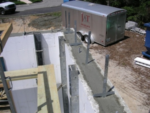 File insulating concrete forms icf after pour jpg Insulated block construction