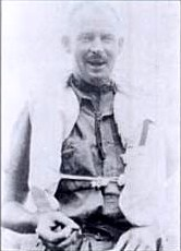 Informal half-portrait of balding man in life jacket and light-coloured shirt