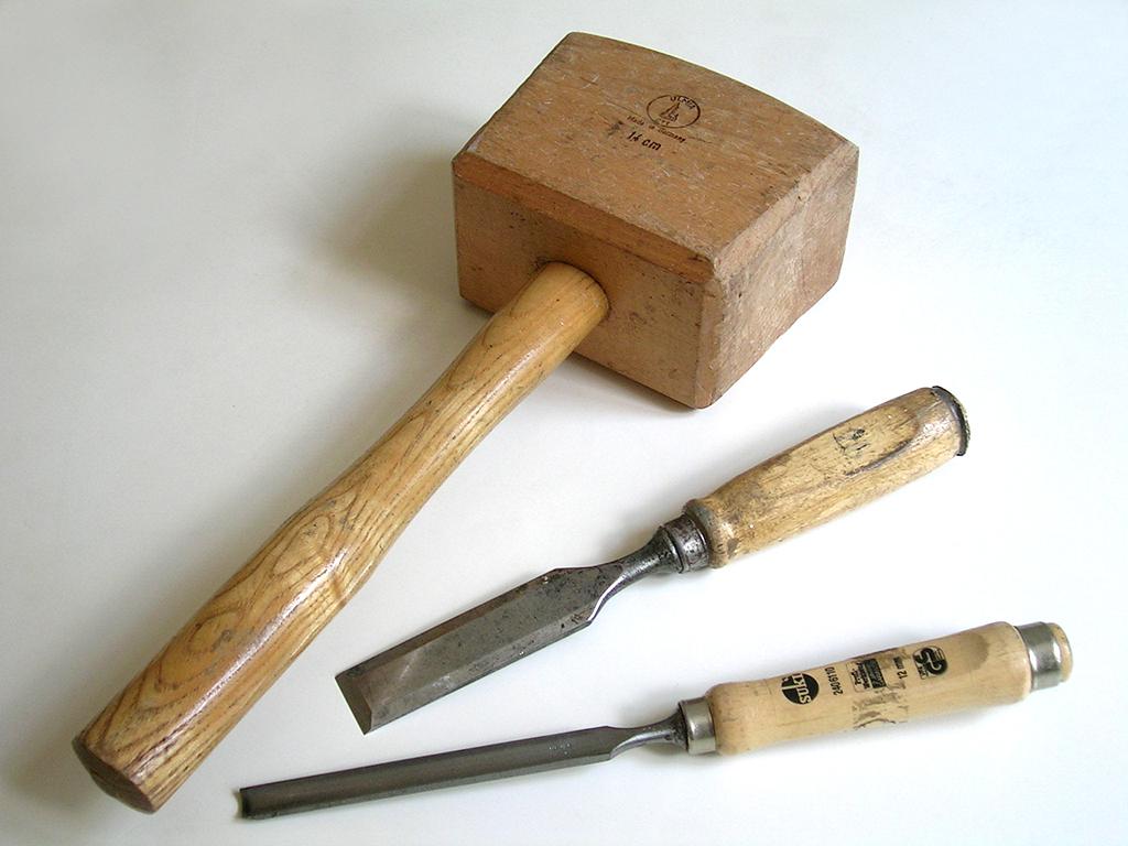 Hammer And Paint Brush Hand